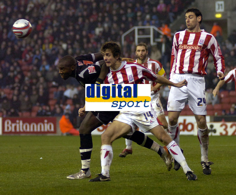 Photo: Matt Bright/Sportsbeat Images.<br /> Stoke City v West Bromwich Albion. Coca Cola Championship. 22/12/2007.<br /> Ishmael Miller of West Bromwich Albion heads clear of Danny Pugh & Rory Delap of Stoke