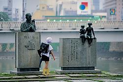 Boy Looking At Memorial Statues
