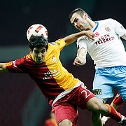 Galatasaray's Juan Emmanuel CULIO (L) and Trabzonspor's Piotr BROZEK (C) during their Turkish superleague soccer derby match Galatasaray between Trabzonspor at the TT Arena in Istanbul Turkey on Sunday, 10 April 2011. Photo by TURKPIX