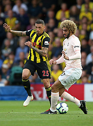 Watford's Jose Holebas (left) and Manchester United's Marouane Fellaini (centre) during the Premier League match at Vicarage Road, Watford