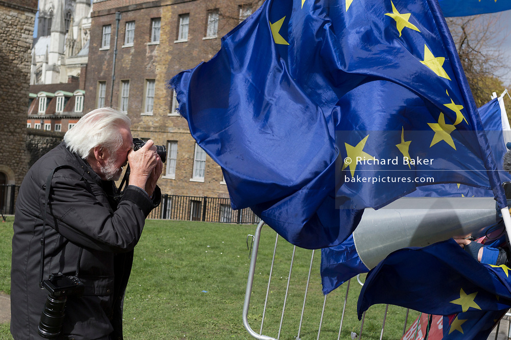 Magnum photographer, Ian Berry at a Brexit protest on College Greeen in Westminster, the morning after another of Prime Minister Theresa May's Brexit deal votes failed again in Parliament, on 13th March 2019, in London, England.
