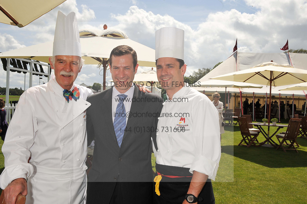 Left to right, chef ANTON MOSIMANN with his sons  PHILIPP MOSIMANN and MARK MOSIMANN at the Cartier Queen's Cup Polo Final, Guards Polo Club, Windsor Great Park, Berkshire, on 17th June 2012.