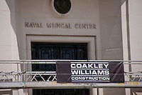 Exterior images of Navy Medical Center high-rise  building with Coakley Williams Construction banner