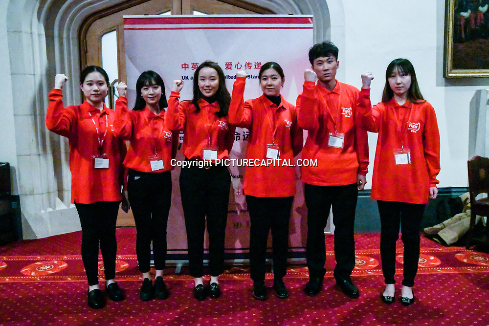 The Chinese volunteer group (Together we fight the virus)at China-UK United We Stand together to fights the #Covid19 at Guildhall, on 28th February 2020, London, UK.