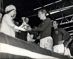 Jul. 30, 1966 - World Cup Football: England win the world cup after defeating West Germany at Wembley. Photo Shows Bobby Morre, the England captain is all smiles after receiving the Jules-Rimet Trophy from H.M. the Queen after England's victory in the World Cup final at Wembley today. (Credit Image: © Keystone Press Agency/Keystone USA via ZUMAPRESS.com)