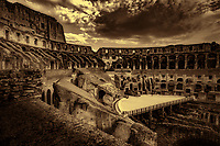 """""""Ring side seat Colosseum - BW""""…<br /> <br /> A sunlit and pleasant view of the ancient and organic Colosseum.  The Colosseum, is an elliptical amphitheatre in the center of the city of Rome, the largest ever built during the Roman Empire. One of the greatest works of Roman architecture and engineering in history, its construction started in 72 AD under the emperor Vespasian and was completed in 80 AD under Titus. Capable of seating 65,000 spectators, it was used for gladiatorial contests and public spectacles such as mock sea battles, animal hunts, executions, re-enactments of famous battles, and dramas based on Classical mythology. The building ceased to be used for entertainment in the early medieval era. It is one of Rome's most popular tourist attractions and still has close connections with the Roman Catholic Church, as each Good Friday the Pope leads a torch lit """"Way of the Cross"""" procession that starts in the area around the Colosseum.  The Colosseum is generally regarded by Christians as a site of the martyrdom of large numbers of believers during the persecution of Christians in the Roman Empire, as evidenced by Church history and tradition.  A Cross stands exultant in the Colosseum center with a plaque stating:  """"The amphitheatre, one consecrated to triumphs, entertainments, and the impious worship of pagan gods, is now dedicated to the sufferings of the martyrs purified from impious superstitions.""""  In viewing many historical sites during my journey in Italy, seeing the iconic Colosseum for the first time…I became awestruck.   It is as grand in person as it appears in the media, and it seems to hold a very mystical aura.  Climbing the ancient steps inside, one cannot help but feel not only the suffering of its past, but the forgiveness and sacrifice of its present stature.  I created this image in the late evening as the guards ushered me out for closing time."""