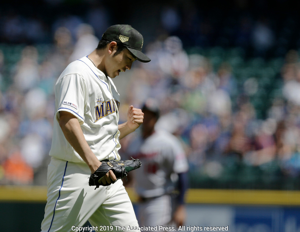 Seattle Mariners starting pitcher Yusei Kikuchi reacts after striking out Minnesota Twins' C.J. Cron for the third out during the third inning of a baseball game, Sunday, May 19, 2019, in Seattle. (AP Photo/John Froschauer)