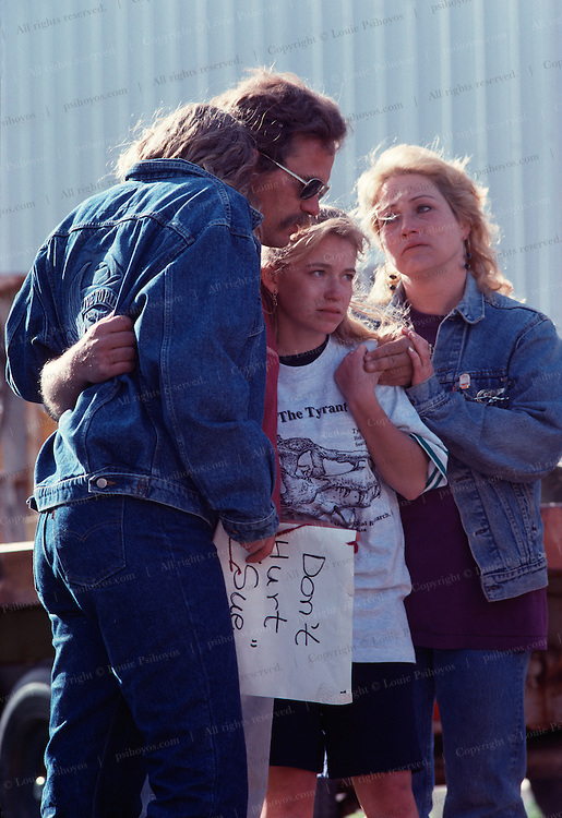 """Pete Larson consols and gets consoled by family and Black Hills Institute members as """"Sue"""" was seized by Federal troops.<br /> <br /> <br /> <br /> <br /> The T.rex called Sue was excavated and prepared by the Black Hills Institute and by their policy named after the discoveror, Sue Hendrcikson, an amateur paleontologist.  (Pete Larson left, Terry Wentz right)"""