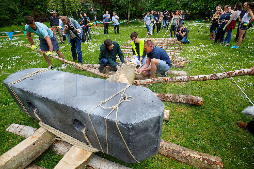 © Licensed to London News Pictures. 23/05/2016. London, UK. UCL students attempt to move a one tonne block strapped to a neolithic wooden sledge in an investigation of the technology used to build prehistoric monuments such as Stonehenge, in Gordon Square, London on Monday, 23 May 2016. The block weighs approximately half as much as the smallest bluestone at Stonehenge and the experiment is part of the UCL Festival of Culture - a week long free festival of events which runs from Monday 23rd - Friday 27th May. Photo credit: Tolga Akmen/LNP