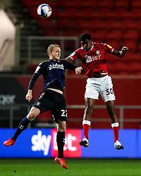 Tyreeq Bakinson of Bristol City is challenged by George Saville of Middlesbrough - Rogan/JMP - 20/10/2020 - Ashton Gate Stadium - Bristol, England - Bristol City v Middlesbrough - Sky Bet Championship.