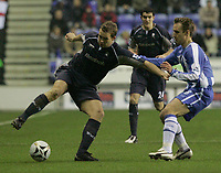 Photo: Dave Howarth.<br /> Wigan Athletic v Bolton Wanderers. Carling Cup.<br /> 20/12/2005. Andreas Johanasson (l) and Joey O,Brien