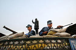 NEPALGANJ, NEPAL, APRIL 15, 2004:Royal  Nepal soldiers guard a statue of the King in Nepalganj, Nepal  April 15, 2004.   (Ami Vitale/Getty Images)