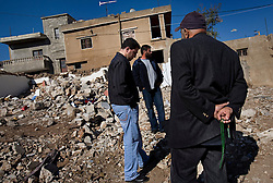 Members of the Al-Akhrass family visit the site where their family members were killed in the war between Israel and Hezbollah, Aytaroun, Southern Lebanon, Oct. 23, 2006.