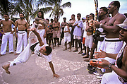 a group of Capoeira aficionados ( a marshal art - dance) practice their art on the streets of Salvador, Bahia, Brazil
