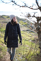 Taylor walks the rocky trails at Cattle Point on a sunny winter day in Victoria, BC