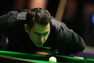 Ronnie O'Sullivan blows dust off the cue ball during the final against Neil Robertson. Betvictor Welsh Open snooker 2016, Final day at the Motorpoint Arena in Cardiff, South Wales on Sunday 21st  Feb 2016.  <br /> pic by Andrew Orchard, Andrew Orchard sports photography.