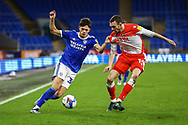 Cardiff City's Perry Ng (38) holds off the challenge of Millwall's Scott Malone (14) during the EFL Sky Bet Championship match between Cardiff City and Millwall at the Cardiff City Stadium, Cardiff, Wales on 30 January 2021.