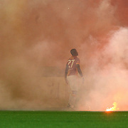 Spectators launched smoke to the stadium during the Turkish Super Cup 2012 soccer derby match Galatasaray between Fenerbahce at the Kazim Karabekir stadium in Erzurum Turkey on Sunday, 12 August 2012. Photo by TURKPIX