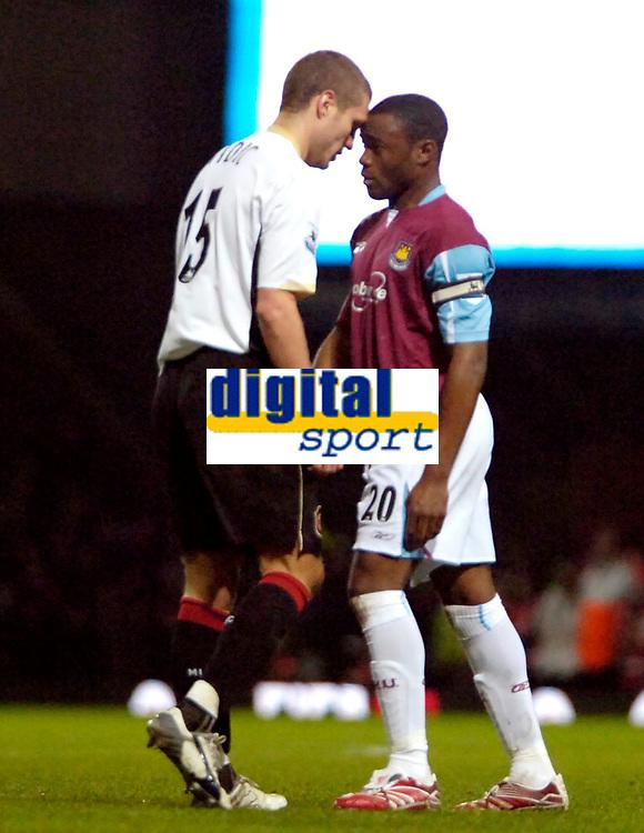 Photo: Ed Godden.<br /> West Ham United v Manchester United. The Barclays Premiership. 17/12/2006. West Ham's Nigel Reo-Coker (R), squares up to Nemanja Vidic.