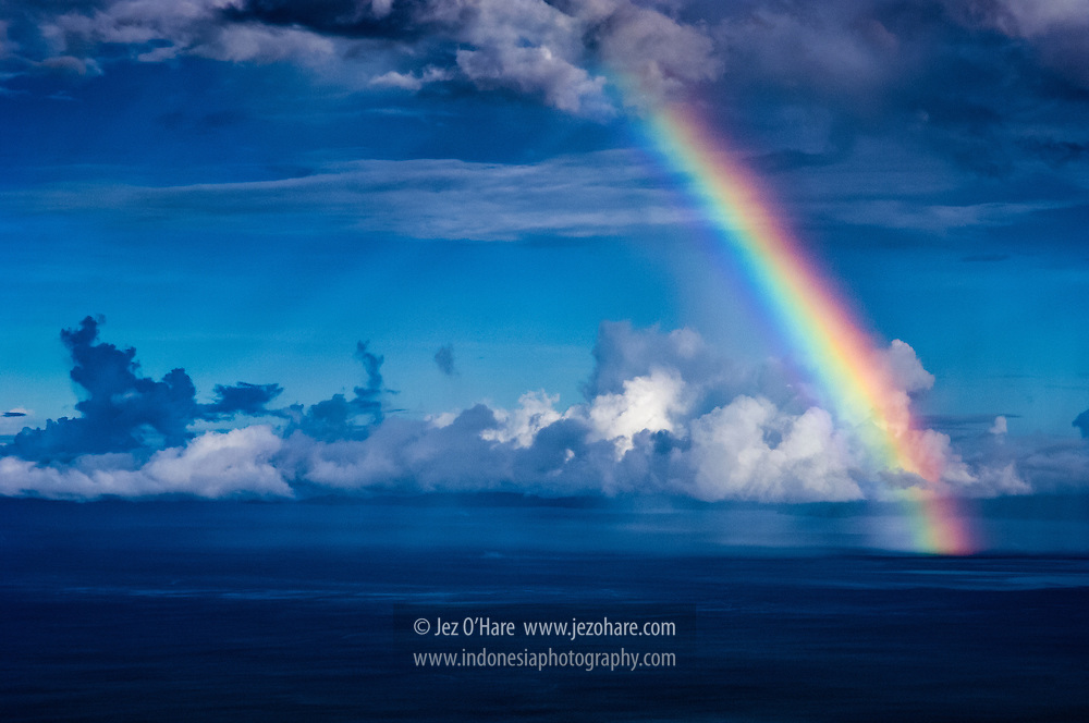 Rainbow near Kabu Schilpad islands, Raja Ampat, Papua, Indonesia.