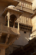 A Jharokha, an Indian covered overhanging balcony at Jaisalmer Fort, the 'Golden Fort'. It is one of the largest forts in the world. Jaisalmer, Rajasthan, India