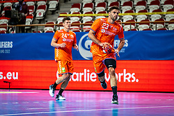 The Dutch handball player Jorn Smits in action during the European Championship qualifying match against Turkey in the Topsport Center Almere.