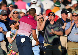 Sergio Garcia tosses a ball to fans in the gallery on the 18th green during the third round of the Masters Tournament at Augusta National Golf Club in Augusta, Ga., on Saturday, April 8, 2017. (Photo by Brant Sanderlin/Atlanta Journal-Constitution/TNS) *** Please Use Credit from Credit Field ***