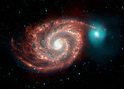 Spitzer Space Telescope infrared image of  Whirlpool Galaxy. Strange structures bridge gaps between dust-rich spiral arms, and show the dust, gas and stellar populations in  the bright spiral galaxy.  Credit NASA. Science Astronomy