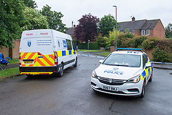 © Licensed to London News Pictures. 21/06/2021. Burnham, UK. Police vehicles at the scene following the death of a man in Wyndham Crescent in Burnham on Monday 20/06/2021. Emergency services were called at approximately 13:10BST to the Buckinghamshire street following reports of an altercation involving a group of men. Shortly after this a 35-year-old man collapsed. Thames Valley Police officers and paramedics attended the scene and performed CPR on the man but he was later pronounced dead. Photo credit: Peter Manning/LNP