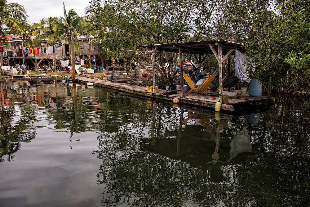 Fisher dwelling and family<br /> Caye Caulker<br /> Ambergris Caye<br /> Belize<br /> Central America
