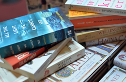 File photo dated 11/0/15 of a pile of books. The number of primary school children saying they enjoy reading has reached record levels - but only a third of teenage boys like to pick up a book, research has found.
