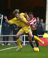 Photo: Andrew Unwin.<br />Sunderland v Southampton. Coca Cola Championship. 11/11/2006.<br />Sunderland's Lewin Nyatanga (R) looks to tackle Southampton's Mario Licka (L).