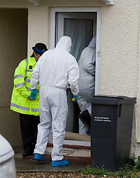 © licensed to London News Pictures. Braintree, UK  06/06/2011. Forensics entering a property on Bartram Avenue in Braintree, Essex today (06/06/2011) where the bodies of a woman and a child were found following a shooting. Officers were called to reports of a firearms incident in the early hours of the morning. Photo credit should read Ben Cawthra/LNP