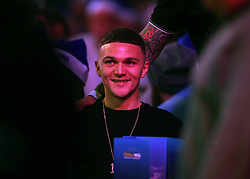 Tottenham player Kieran Trippier watches the action during day three of the William Hill World Darts Championships at Alexandra Palace, London.