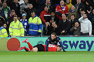 Wayne Rooney of Manchester United tackle on Jordon Mutch which earned him a yellow card from referee Neil Swarbrick.<br /> Barclays Premier League match, Cardiff city v Manchester Utd at the Cardiff city stadium in Cardiff, South Wales on Sunday 24th Nov 2013. pic by Phil Rees, Andrew Orchard sports photography,