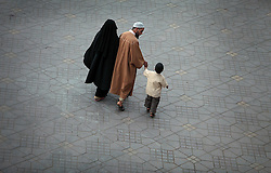 Couples relax while walking through Djemaa el Fna square, meaning Place of the Dead, in Marrakech, Morocco on May 9, 2009.