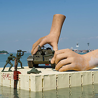 """VENICE, ITALY - JUNE 04:  """"This is not a game"""" an installation by Lorenzo Quinn in front of Isle of S. Servolo on June 4, 2011 in Venice, Italy. The Venice Art Biennale will run from June 4 to November 27, 2011."""