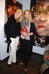 Left to right, CATHARINA LUEBKE-DETRING and KATHERINE HOEGER at a private view of paintings by Lita Cabellut and Russian artist Yuri Kuper at Opera Gallery, 134 New Bond Street, London on 2nd April 2008.<br /><br />NON EXCLUSIVE - WORLD RIGHTS