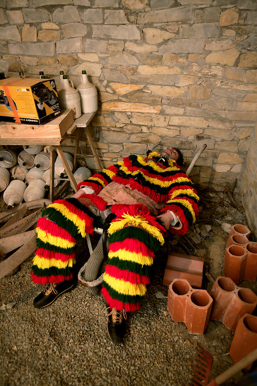 """One """"Careto"""" lies knocked-out in the cellar. Most of men who wear this costume spend the day drinking red wine and scaring girls and women."""