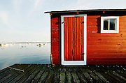A red shack on a pier in Beals Island, Maine.