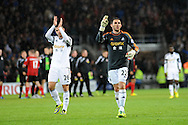 Angel Rangel of Swansea City gestures to the travelling fans at full time.<br /> Barclays Premier League match, Cardiff city v Swansea city at the Cardiff city stadium in Cardiff, South Wales on Sunday 3rd Nov 2013. pic by Phil Rees, Andrew Orchard sports photography,