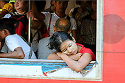 A passenger sleeping inside a carriage on the Yangon Circular Railway on 17th May 2016 in Yangon, Myanmar. The railway, a narrow gauge local commuter trail network serving Yangon metropolitan area is a 28.5 mile 45.9 km 39 station loop system. This British built rail-loop connects Yangon to its satellite towns and villages