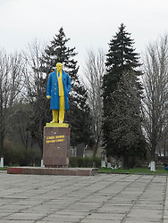 A statue of Vladimir Lenin painted in yellow and blue, the colours of the Ukranian flag, stands in the central square in the town of Vlika Novosilka in eastern Ukraine.