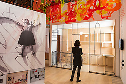 © Licensed to London News Pictures. 17/11/2016. London, UK. A staff member views a display as The Design Museum opens in its new home on Kensington High Street, west London.  Housed in the former Commonwealth Institute, the building has been redesigned by John Pawson following an investment of £83m, and a five-year construction process for its future role as the world's leading institution dedicated to contemporary design and architecture. Photo credit : Stephen Chung/LNP