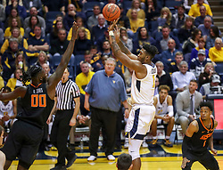 Jan 12, 2019; Morgantown, WV, USA; West Virginia Mountaineers forward Derek Culver (1) shoots a jumper during the second half against the Oklahoma State Cowboys at WVU Coliseum. Mandatory Credit: Ben Queen-USA TODAY Sports