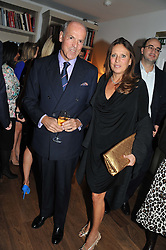 MASSIMO & SARA CARELLO at a dinner hosted by Marlon and Nadya Abela in aid of Kids Company at Morton's, Berkeley Square, London on 25th September 2012.