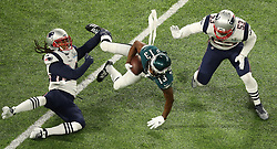 Philadelphia Eagles wide receiver Nelson Agholor (13) falls forward during the Eagles' first drive as Stephon Gilmore, left, and Kyle Van Noy defend in Super Bowl LII on Sunday, February 4, 2018 in Minneapolis, Minn. Photo by Elizabeth Flores/Minneapolis Star Tribune/TNS/ABACAPRESS.COM