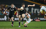 Ben Smith of the All Blacks breaks the tackle of Tom Wood of England during the third rugby test between the All Blacks and England played at Waikato Stadium in Hamilton during the Steinlager Series - All Blacks v England, Hamiton, 21 June 2014<br /> www.photosport.co.nz