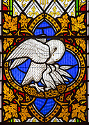 Stained glass window in church of Saint Michael, Peasenhall, Suffolk, England, UK circa 1861 by Thomas Willement, detail of pelican feeding its young symbol of sacrifice of Jesus Christ