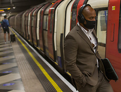 © Licensed to London News Pictures.  14/07/2021. London, UK. Members of the public use London Underground network as face covering must be worn on London's transport despite easing Lockdown restriction on 19 July. Photo credit: Marcin Nowak/LNP